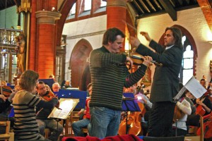 Magnus Johnston rehearsing with the orchestra